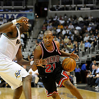 19 December 2007:   Chicago Bulls guard Chris Duhon (21) drives to the basket in the second half against Washington Wizards center Andray Blatche (32) at the Verizon Center in Washington, D.C.  The Bulls defeated the Wizards 95-84.