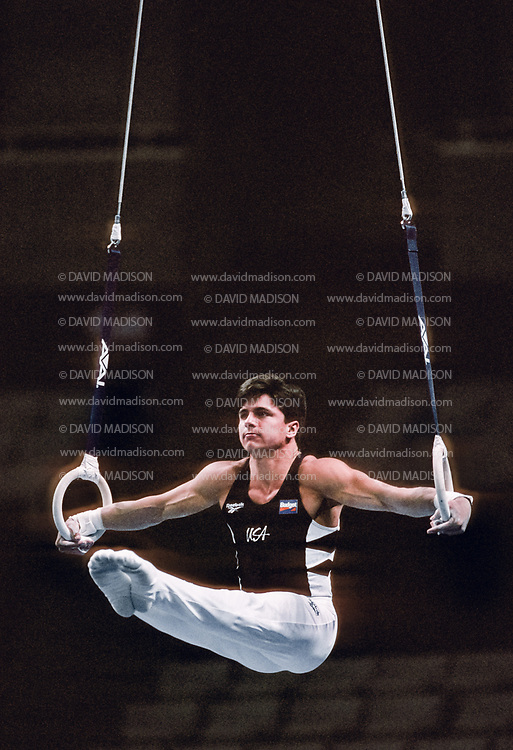 SAN JOSE, CA - JULY 17:  Chris Waller of the United States performs on the still rings during the Budget Rent A Car Invitational Gymnastics Meet held on July 17, 1995 at the San Jose Arena in San Jose, California.  (Photo by David Madison/Getty Images)