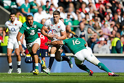 England replacement Owen Farrell is tackled by Ireland Full Back Simon Zebo and replacement Richardt Strauss - Mandatory byline: Rogan Thomson/JMP - 07966 386802 - 05/09/2015 - RUGBY UNION - Twickenham Stadium - London, England - England v Ireland - QBE Internationals 2015.