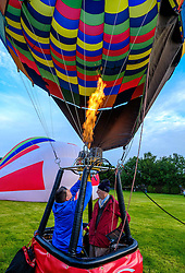 Strathaven Scotland UK 27th August 2016 - The Strathaven Balloon Festival is an annual event and the only one of its kind in Scotland held in 2016 from 26th - 28th August. The first flights of the festival took place at dawn on Saturday 27th August <br /> <br /> Firing the burners in preparation for a flight.<br /> <br /> (c) Andrew Wilson   Edinburgh Elite media