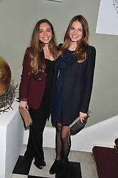 Left to right, AYESHA SHAND daughter of Mark Shand and CHLOE GARLAND at a champagne reception to launch The Big Egg Hunt presented by Faberge in aid of the charities Action for Children and Elephant Family held at 29 Portland Place, London on 18th January 2012.