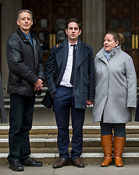 "© Licensed to London News Pictures. 29/01/2016. London, UK. Heterosexual couple CHARLES KEIDAN (C) and REBECCA STEINFELD (R) stand next to British human rights campaigner  PETER TATCHELL as they leave the Royal Courts of Justice in London, where they have lost their High Court battle to have a civil partnership.. The couple, who are both academics and live in London, argued that the Government's position on civil partnerships is ""incompatible with equality law"".  Photo credit: Ben Cawthra/LNP"