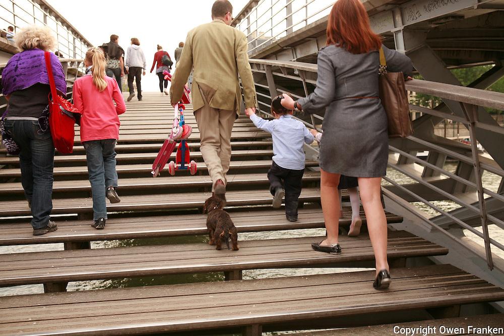 ..pedestrians, solferino bridge, Paris - Photograph by Owen Franken