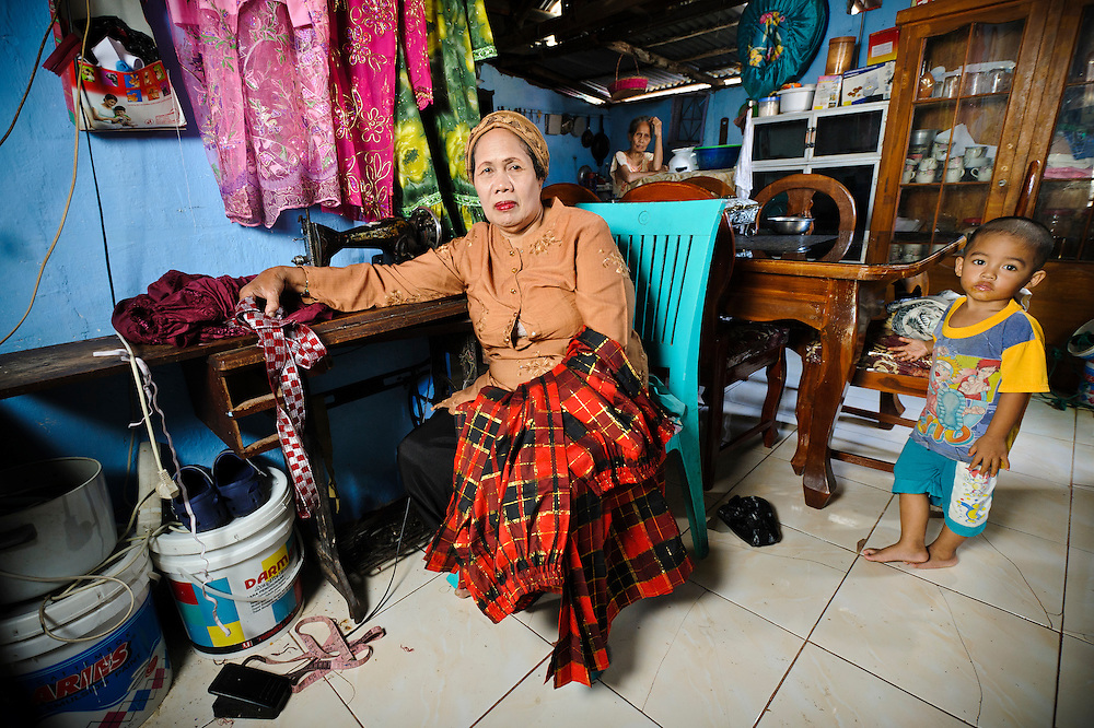 Haji Rahmatiah at her home in the Jongaya leprosy settlement, Makassar, Sulawesi, Indonesia. Haji Rahmatiah, 62, has lived in Jongaya for over 20 years.  She was 7 when she discovered she had leprosy but stayed in Pare Pare, Sulawesi, until 1974 when she moved to Makassar.  She met her husband, Ilyas, 62, at the Daya leprosy hospital in the city whilst they were both receiving treatment.  They have no children but her extended family live with her in the same house.  Ilyas is blind and so Haji Rahmatiah supports her family by working as a tailor and by making bags and handicrafts.  She also used to run a saving and loan scheme used by members of a self-help group in Jongaya.