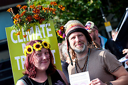 © Licensed to London News Pictures. 04/10/2015. An estimated 80 thousand peopl take part in a National Demonstration march through the city. A week of pro-peace, anti-austerity, anti-war, anti-Tory, protests dubbed 'Take Back Manchester' has been  organised by The People's Assembly and timed to coincide with the Conservative Party Conference in Manchester on 4th - 7th Oct 2015. Over 40 events are planned, including a speech by new Labour leader Jeremy Corbyn timed to compete with closing speech of Tory leader David Cameron. Photo credit: Graham M. Lawrence/LNP