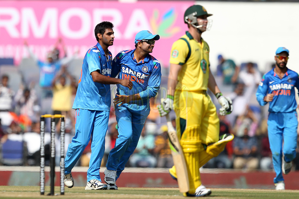 Bhuvneshwar Kumar celebrates wicket of Phillip Hughes during the sixth Star Sports Series One Day International (ODI) between India and Australia held at the VIDARBHA CRICKET ASSOCIATION STADIUM, NAGPUR on the 30th October 2013<br /><br />Photo by Prashant Bhoot - BCCI - SPORTZPICS  <br /><br />Use of this image is subject to the terms and conditions as outlined by the BCCI. These terms can be found by following this link:<br /><br />http://sportzpics.photoshelter.com/gallery/BCCI-Image-terms-and-conditions/G00004IIt7eWyCv4/C0000ubZaQCkIRgQ