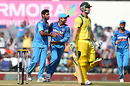 Bhuvneshwar Kumar celebrates wicket of Phillip Hughes during the sixth Star Sports Series One Day International (ODI) between India and Australia held at the VIDARBHA CRICKET ASSOCIATION STADIUM, NAGPUR on the 30th October 2013<br />