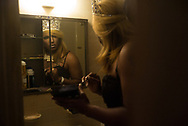 A performer takes a last look in the mirror at a fundraiser for the Orlando shooting victims families held at Paradise nightclub in the Empress Hotel in Asbury Park, New Jersey on Friday, June 17, 2016.