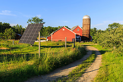 Solar panels and the barn at the Sullivan Farm in Nashua, New Hampshire.