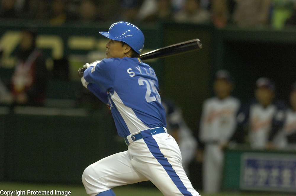 Team Korea's Seung Yeop Lee hits a two-run homer in the 8th inning against Team Japan in the Pool A Championship Game of the World Baseball Classic at Tokyo Dome, Tokyo, Japan.