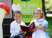No fee for Repro: 26/07/2012.'Alice' Kayla Cooke aged 5 from Drumcondra, Dublin and Brandon Best-Blake aged 5 from Clondalkin as the 'Rabbit' are pictured reading 'Alice in Wonderland? at the announcement that leading Irish authors Cathy Kelly and Ireland's new children's laureate Niamh Sharkey pledged their support for the Eason 'Get Into Reading' campaign which aims to highlight the importance of reading, especially with young children. Eason commissioned research into the nation's reading habits which revealed almost one in five (18%) Irish parents never read to their children. Eason is asking the Irish public to pledge their support at Easons.com/getintoreading. Picture Andres Poveda CPR.