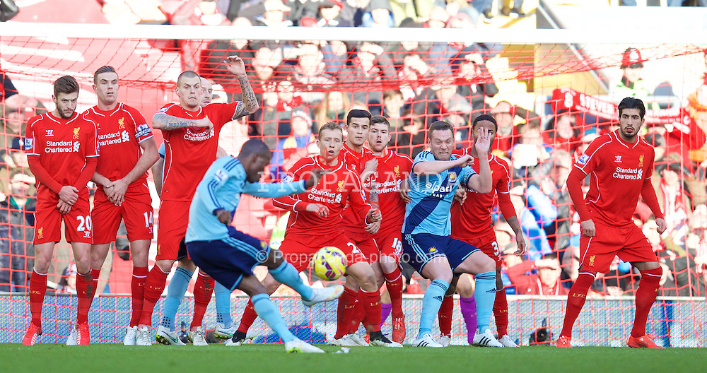 LIVERPOOL, ENGLAND - Saturday, January 31, 2015: Liverpool's Adam Lallana, Jordan Henderson, Martin Skrtel, Lucas Leiva, Philippe Coutinho Correia, Alberto Moreno, Raheem Sterling and Emre Can defend West Ham United free-kick with captain Kevin Nolan in the wall during the Premier League match at Anfield. (Pic by David Rawcliffe/Propaganda)