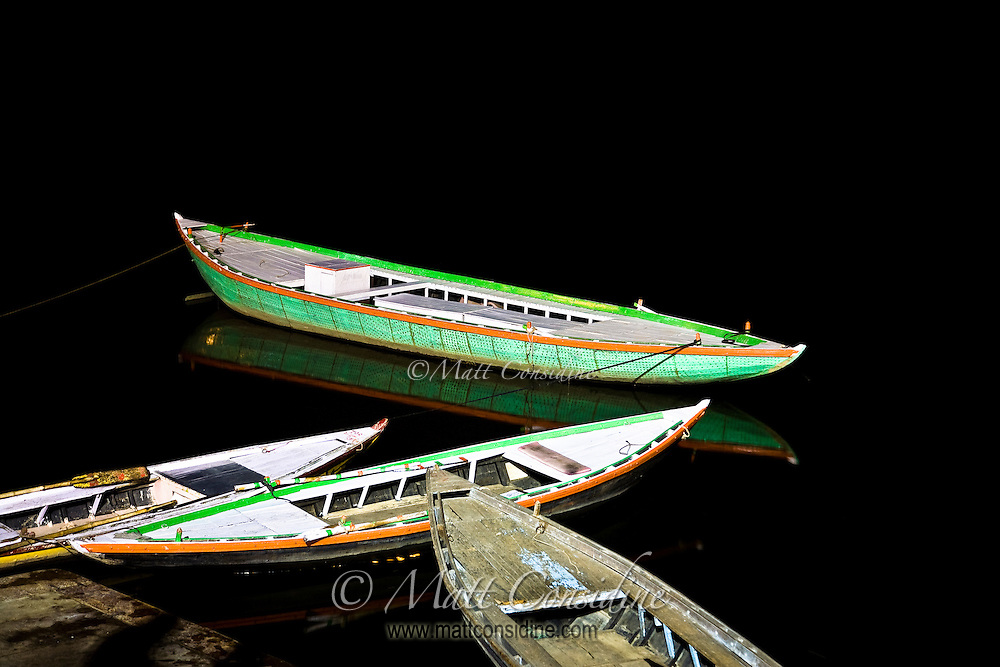 Ferry boats and their reflection in the dark waters of a quiet Ganges.<br /> (Photo by Matt Considine - Images of Asia Collection)