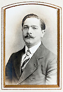 1900s portrait of adult man in golden passe-partout frame