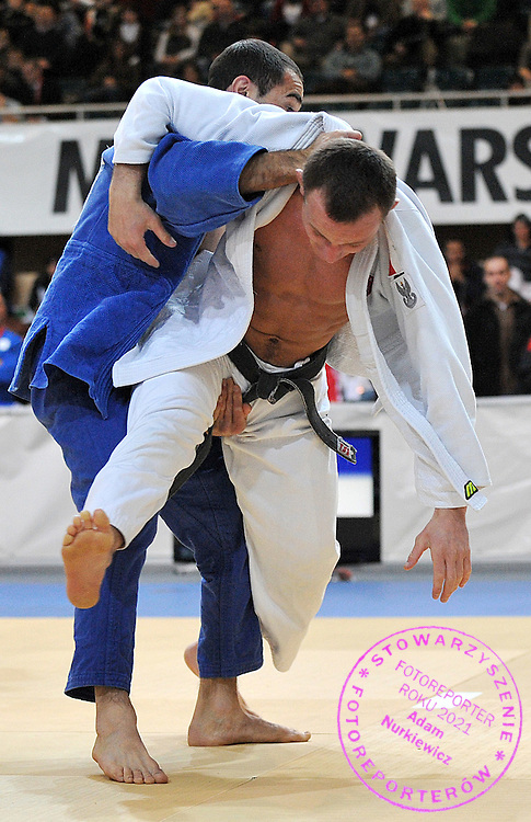 (WHITE) MARIUSZ JANICKI (POLAND) & (BLUE) LAVRETIS ALEXANIDIS (GREECE) DURING 66 KG WEIGHT CATEGORY FIGHT ON JUDO WORLD CUP MEN AT ARENA URSYNOW HALL IN WARSAW, POLAND...WARSAW , POLAND , FEBRUARY 28, 2009..( PHOTO BY ADAM NURKIEWICZ / MEDIASPORT )..PICTURE ALSO AVAIBLE IN RAW OR TIFF FORMAT ON SPECIAL REQUEST.