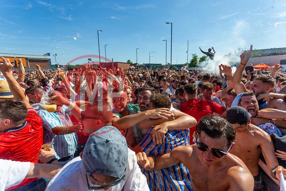 Fans celebrates as Raheem Sterling scores Englands second goal of the game - Ryan Hiscott/JMP - 07/07/2018 - FOOTBALL - Ashton Gate - Bristol, England - Sweden v England, World Cup Quarter Final, World Cup Village at Ashton Gate