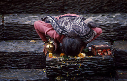 KATHMANDU, NEPAL- Devout Hindus make a ritual of bathing and worshiping in the holy waters of the Baghmati River. The Pashupatinath Temple, on the banks of the Baghmati River, is the holiest Hindu Temple in Nepal. It is here that the faithful come to die and be cremated so that they may attain salvation.  (PHOTO © JOCK FISTICK)