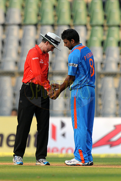 Praveen Kumar of India takes the ball out of Field umpires pocket during the 4th One Day International ( ODI ) match between India and England held at the Wankhede Stadium, Mumbai on the 23rd October 2011..Photo by Pal Pillai/BCCI/SPORTZPICS