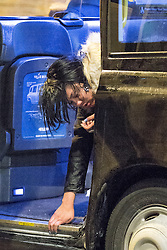 "© Licensed to London News Pictures . 20/12/2014 . Manchester , UK . A woman leans out of the open door of a black taxi to vomit . "" Mad Friday "" revellers out in the rain and cold in Manchester . Mad Friday is typically the busiest day of the year for emergency services , taking place on the last Friday before Christmas when office Christmas parties and Christmas revellers enjoy a night out .  Photo credit : Joel Goodman/LNP"