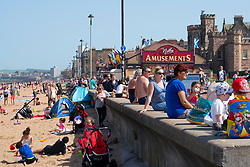 Portobello,Scotland, UK. 28 June, 2019. Warm temperatures and unbroken sunshine brought hundreds of people and families to enjoy this famous beach outside Edinburgh. Promenade at Portobello is busy with families .