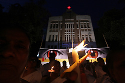 May 1, 2019 - Mumbai, India - Women hold candles as they pay tribute to the Sri Lankan blasts victims, outside a church in Mumbai, India on 01 May 2019. More than 300 people killed in a coordinated series of blasts on 21 April 2019 in Sri Lankan as per media report. (Credit Image: © Himanshu Bhatt/NurPhoto via ZUMA Press)