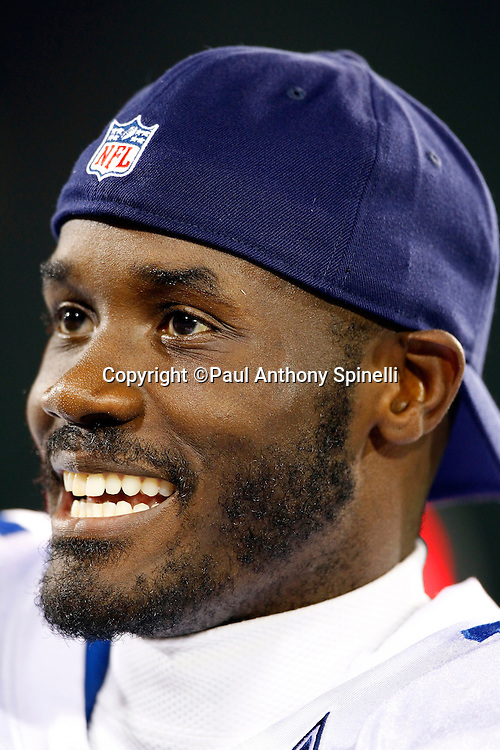 Dallas Cowboys wide receiver Roy Williams (11) smiles on the sidelines during the NFL Pro Football Hall of Fame preseason football game between the Dallas Cowboys and the Cincinnati Bengals on Sunday, August 8, 2010 in Canton, Ohio. The Cowboys won the game 16-7. (©Paul Anthony Spinelli)