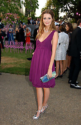 Actress MISCHA BARTON at the Serpentine Gallery Summer party sponsored by Yves Saint Laurent held at the Serpentine Gallery, Kensington Gardens, London W2 on 11th July 2006.<br />