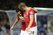 Bristol City striker Aaron Wilbraham (18) celebrates with goalscorer Bristol City defender Derrick Williams (3) after scoring the opening goal during the Sky Bet Championship match between Brighton and Hove Albion and Bristol City at the American Express Community Stadium, Brighton and Hove, England on 20 October 2015. Photo by Geoff Penn.