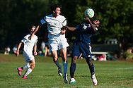 Burlington's Maenda Bienfait Badibang (21) heads the ball during the boys soccer game between the The Burlington Seahorses and the Rice Green Knights at Rice Memorial high School on Tuesday afternoon September 15, 2015 in South Burlington, Vermont. (BRIAN JENKINS/for the FREE PRESS)