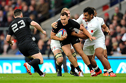 Israel Dagg of New Zealand is tackled by Billy Vunipola of England - Photo mandatory by-line: Patrick Khachfe/JMP - Mobile: 07966 386802 08/11/2014 - SPORT - RUGBY UNION - London - Twickenham Stadium - England v New Zealand - 2014 QBE Internationals