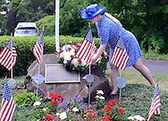 Susan Whitenack lays a wreath at the memorial site during the Maplewood section's 70th anniversary celebration Saturday, June 18, 2016 in Doylestown, Pennsylvania.   (Photo by William Thomas Cain)