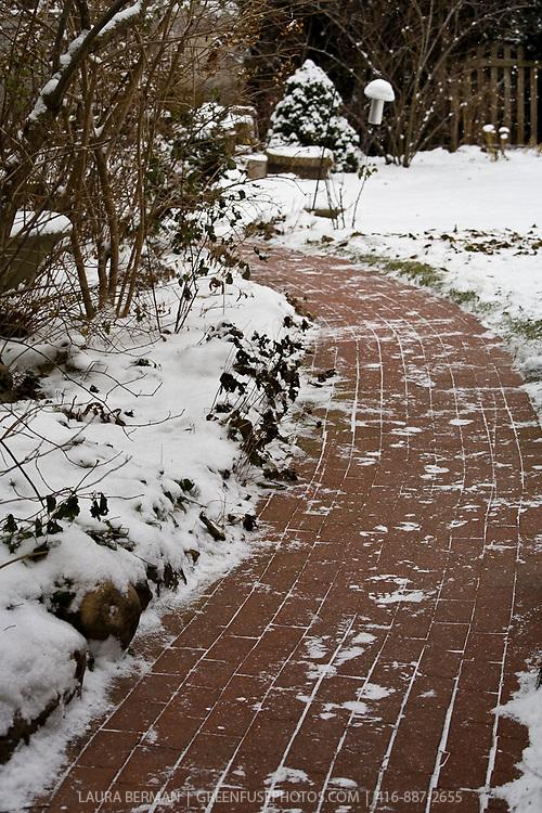 A brick path in the snow.