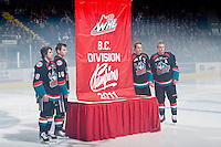 KELOWNA, CANADA, OCTOBER 1: Shane McColgan #18, Spencer Main #16, Colton Sissons #15 and Kevin Smith #3 of the Kelowna Rockets raise the 2011 Division Championship banner on October 1, 2011 at Prospera Place in Kelowna, British Columbia, Canada (Photo by Marissa Baecker/Getty Images) *** Local Caption ***