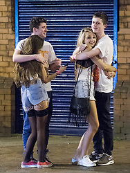 "© Licensed to London News Pictures . 22/10/2012 . Manchester , UK . Two couples hug each other tightly . Students attend a Carnage UK pub crawl at bars in Manchester 's Deansgate Locks with a fancy dress theme of "" Pimps and Hoes "" . The event has been criticised for encouraging binge drinking , sexism and anti-social behaviour . Photo credit : Joel Goodman/LNP"