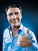 caucasian man thumb up portrait isolated studio on black background