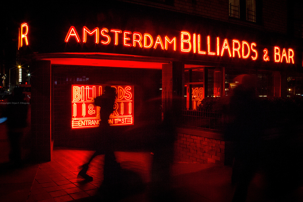 Red neon signs on the facade of the Amsterdam Billiards & Bar in East Village in New York.