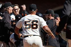 SAN FRANCISCO, CA - MAY 25: Brandon Crawford #35 of the San Francisco Giants is congratulated by teammates after hitting a walk off RBI single against the San Diego Padres during the tenth inning at AT&T Park on May 25, 2016 in San Francisco, California. The San Francisco Giants defeated the San Diego Padres 4-3 in 10 innings. (Photo by Jason O. Watson/Getty Images) *** Local Caption *** Brandon Crawford