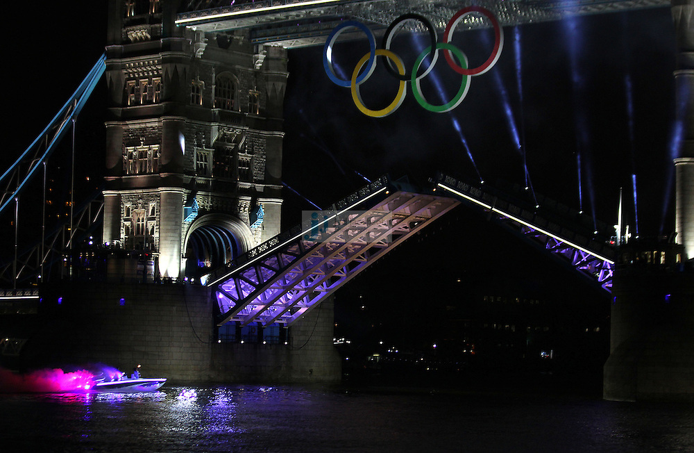 The Olympic Flame passes under the Tower Bridge on a boat prior to the Opening Ceremonies for the Olympic Games in London, England  on July 27, 2012..(Jed Jacobsohn/for The New York Times)....