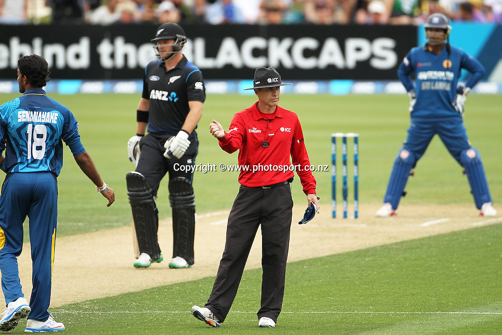 Umpire Chris Gaffaney signals a four off the bat of Corey Anderson of the Black Caps during the first ODI cricket game between the Black Caps v Sri Lanka at Hagley Oval, Christchurch. 11 January 2015 Photo: Joseph Johnson / www.photosport.co.nz
