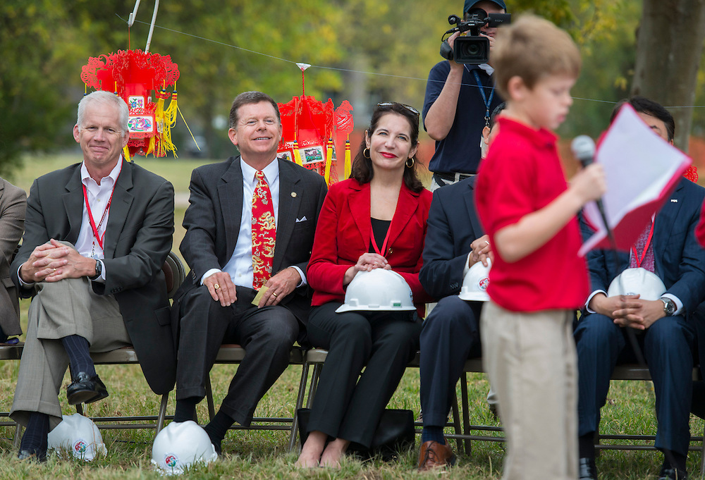 Houston ISD trustees Michael Lunceford, left, and Harvin Moore listen to comments during a groundbreaking ceremony for the new Mandarin Chinese Language Immersion Magnet School, December 6, 2014.