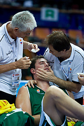 Slobodan Macura, injured Primoz Brezec and Xevdet Hoxha of Slovenia during the EuroBasket 2009 Semi-final match between Slovenia and Serbia, on September 19, 2009, in Arena Spodek, Katowice, Poland. Serbia won after overtime 96:92.  (Photo by Vid Ponikvar / Sportida)