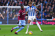 Pedro Obiang of West Ham United (14) ad Philip Billing of Huddersfield Town (8) come together during the Premier League match between Huddersfield Town and West Ham United at the John Smiths Stadium, Huddersfield, England on 10 November 2018.