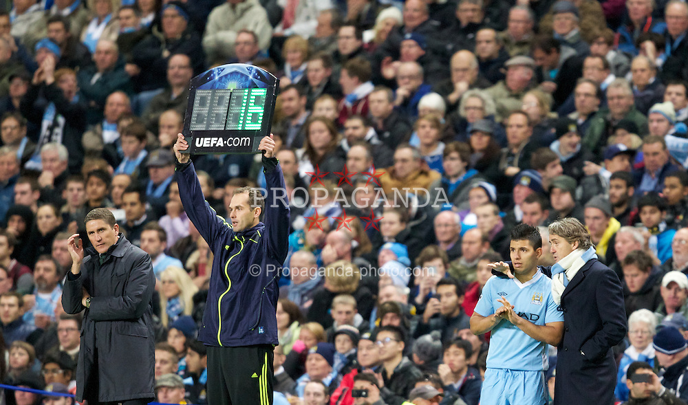 MANCHESTER, ENGLAND - Tuesday, Octover 18, 2011: Manchester City's manager Roberto Mancini talks with Sergio Aguero before he comes on as a substitute with Villarreal CF's head coach Juan Carlos Garrido to the left during the UEFA Champions League Group A match at the City of Manchester Stadium. (Pic by Vegard Grott/Propaganda)