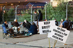© licensed to London News Pictures . 27/07/2012 . Manchester , UK . Protesting farmers blockade Robert Wiseman Dairies in Trafford Park , Manchester . Protesters said Robert Wiseman had not increased the price they paid for their milk and were intending to reduce the price in August . A worker at Robert Wiseman reported that 99 milk delivery lorries were prevented from leaving the depot by the blockade . Photo credit : Joel Goodman/LNP