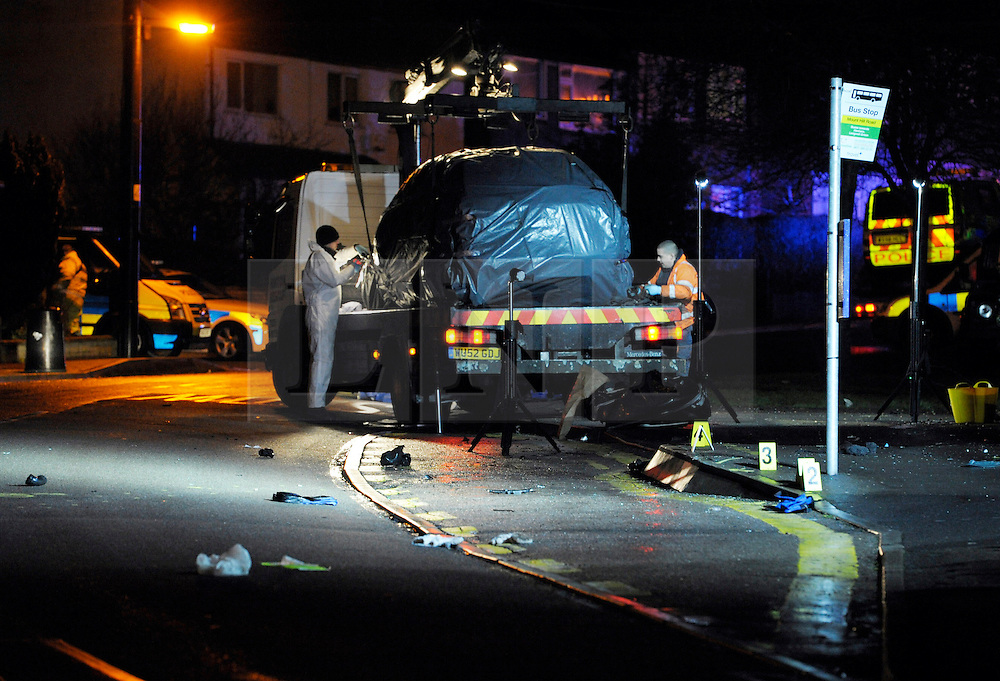 © Licensed to London News Pictures. 27/01/2013. Bristol, UK. A car covered by a sheet on a recovery vehicle is made ready for removal from the scene where two cyclists, a man and a woman, died after they were involved in a hit and run accident with a vehicle in Lower Hanham Road, Hanham, Bristol.  27 January 2013..Photo credit : Simon Chapman/LNP