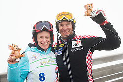 Simona Seliskar, wife of Andrej Jerman and Ivica Kostelic of Croatia during last race of Andrej Jerman, Slovenian best downhill skier when he finished his professional alpine ski career on April 6, 2013 in Krvavec Ski resort, Slovenia. (Photo By Vid Ponikvar / Sportida)
