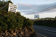 A major protest is breaking out along the Wild Atlantic way with new fencing tats destroys the walls that have been there for 1,000s of years. These signs are near kinvara in Co. Galway. Photo: Andrew Downes, XPOSURE