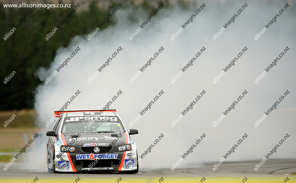 Simon Evans of Auckland lets off smoke, during the Highlands BNT V8 SuperTourers, held at Highlands Motorsport Park, Cromwell, Otago, New Zealand. 25 January 2014. Credit: Joe Allison / allisonimages.co.nz
