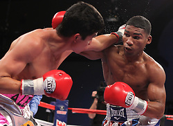 March 26, 2011; Atlantic City, NJ, USA; Yuriorkis Gamboa (red, white, blue trunks) and Jorge Solis (silver/pink trunks) during their 12 round IBF/WBA World Featherweight Championship bout at the Adrian Phillips Ballroom.