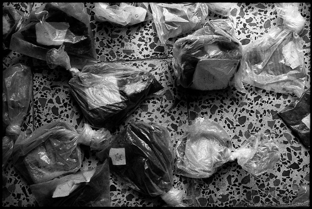 Plastic bags hold unreadable identification cards and other evidence, found in a mass grave near Al-Musayab, Iraq, now in the sports hall, which has become the home of an Iraqi human rights organization which is overseeing the exhumations of bodies from local mass graves. People come from all over to check the clothing and ID cards of the bodies, looking for relatives.